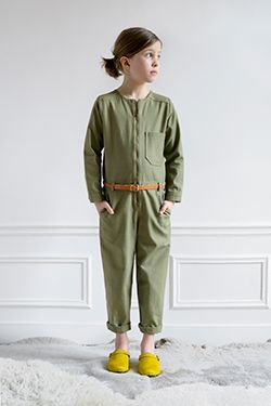 Army green jumpsuit and shocking yellow kicks. #designer #kids #fashion
