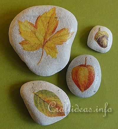 Cute....top layer of fall napkin...cut out image, paing mod podge onto rock, let dry for 1 min. then place napkin image on the rock and top w/ another layer of mod podge!  Simple!