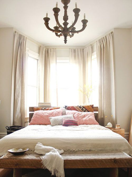 Bed in the windows, would be nice to build a nightstand between the bed and the window