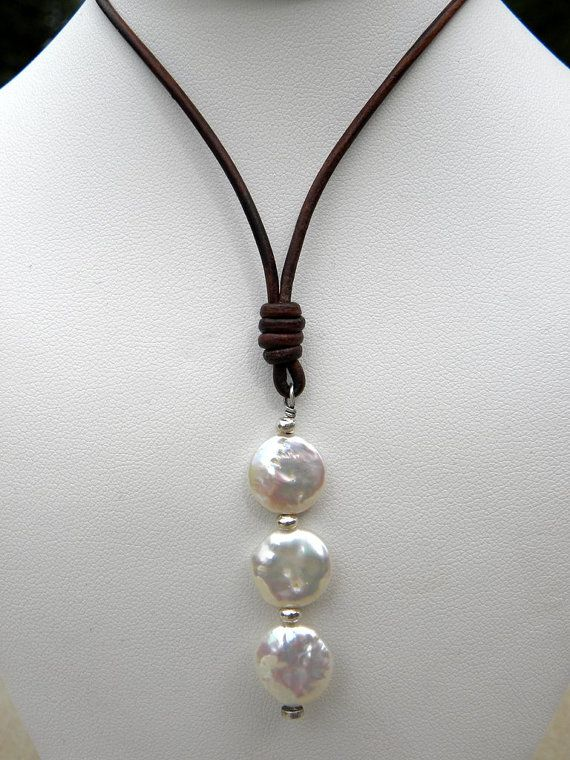 Natural, iridescent white coin pearls with brilliant luster, artisan sterling silver and soft naturally dyed dark chocolate leather this stunning combination will make a statement! Modern yet classic this is a truly unique piece like each one of this amazing pearls!  The necklace is 16 long but if you need a different size please contact me or leave a note at check out.