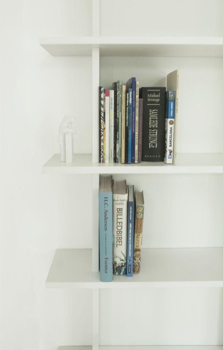 Custom made bookshelf with a white laminate finish. From our bespoke kitchen Kildevældsgade.