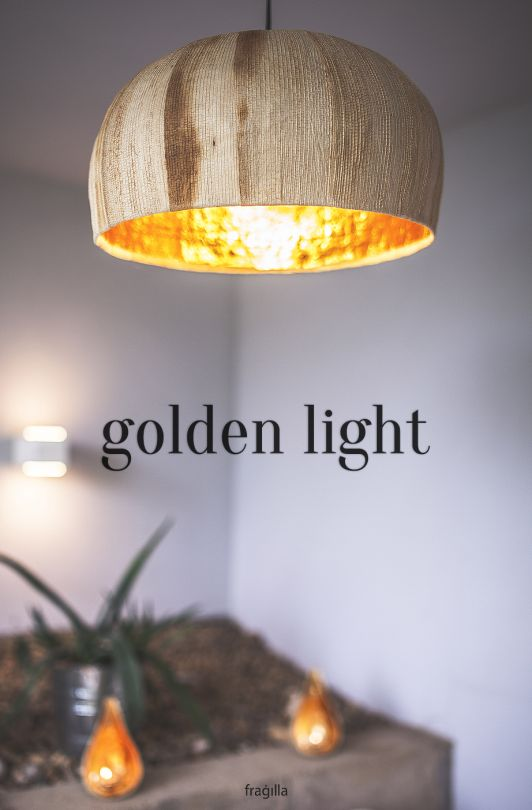 Let the spirituality and peace of the orient touch your home with this Golden Light made from tropical banana trees and buddha gold. | fragilla.com