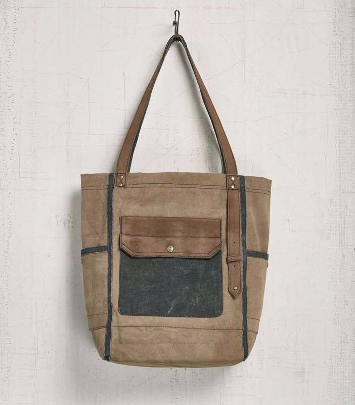Mona B Oasis Up-Cycled Tote Bag The Oasis tote bag is an everyday accessory sized to carry the day's must-haves. Made from recycled canvas and leather, this neutral tote suits a day-to-day style and i