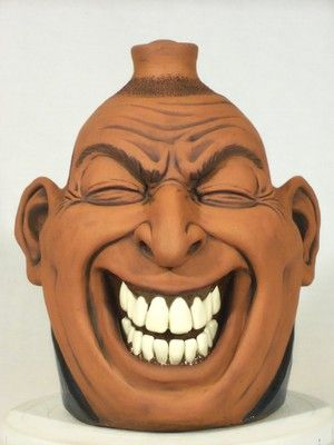 face jug - Southern Folk Pottery