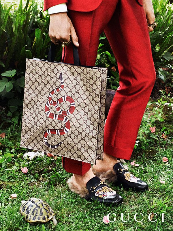 Discover more gifts from the Gucci Garden. The kingsnake features on the House's GG Supreme canvas tote bag by Alessandro Michele.
