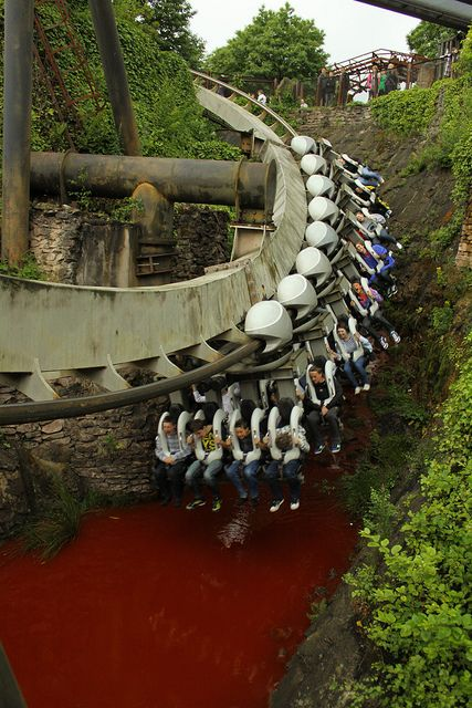 Nemesis, Alton Towers, UK - largely subterranean and very intense inverted coaster, seen here racing over a bloody stream