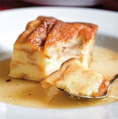 Famous bread pudding featured on Diners, Drive Ins and Dives ~    Makes 8 to 10 servings    1 (1-pound, 6-ounce) loaf Texas toast bread, divided  1 (15-ounce) loaf French bread, cut into 1-inch cubes  2 cups heavy whipping cream  2 cups half-and-half  2 cups milk  2 cups sugar  4 Eggs  1/2 teaspoon vanilla extract     Cognac Sauce (recipe follows)
