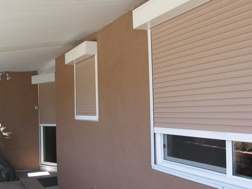 rolladen shutters: privacy, security and weatherproofing....perfect for a tiny little house on wheels!