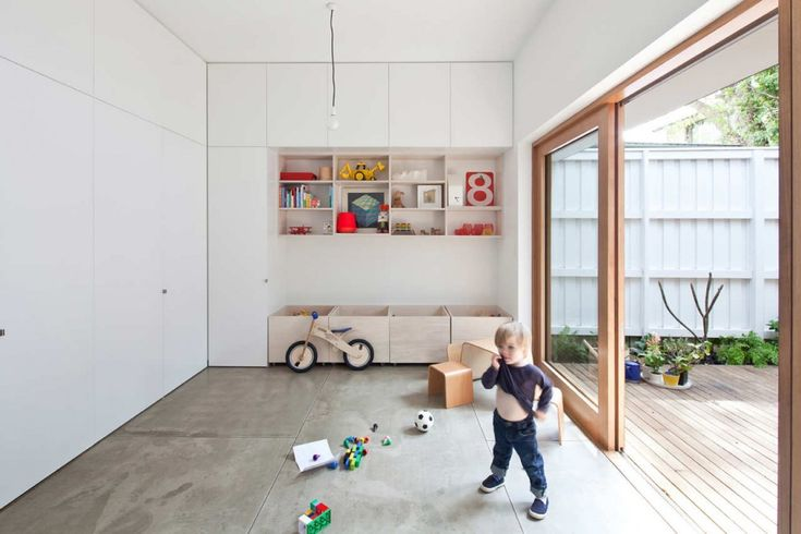 playroom! I think it's smart to have some hard floor they can't hurt, maybe a rug would be nice.