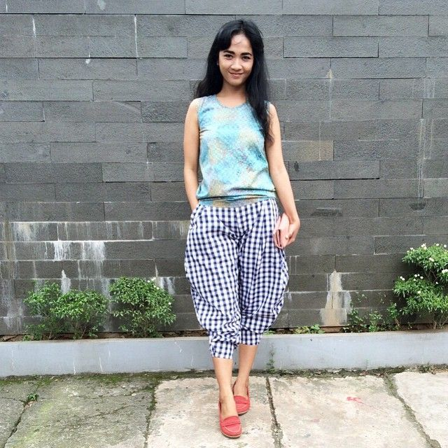 wearing swanstwenty sleeveless batik top and tartan lucy pants... u can grab it at www.odioli.com also
