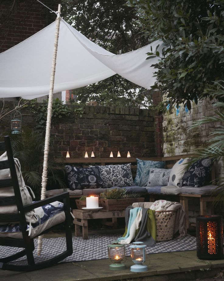 Create a cosy bench area with cushions, throws and lighting