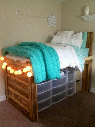 Dorm room - add some wood to the front for a prettier look - maybe add a shelf to the wood - shelf could hold your text books, put desk in front of the wood - could also do one of those cubic self standing shelf in front of bed and put desk against that for more storage