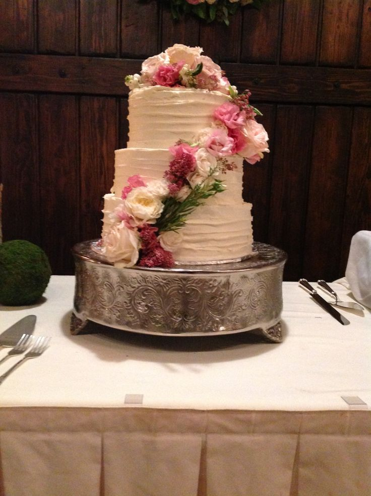 wedding cake with flowers down the side beautiful three tier cake with flowers coming the 26881