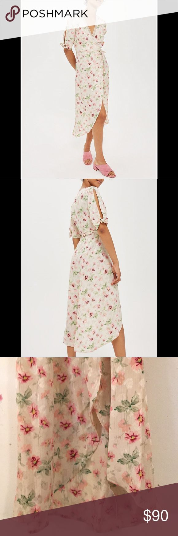 """Topshop Floral-print Jacquard Dress Size US 4. Wrap around front fastening at waist, v-neck with tie detail at cuffs, all over jacquard floral pattern, fitted waist, frills detailing, lace trims, curved hem, 100% polyester. Length: 35"""" (front hemline) to 47"""" (back hemline). Sleeve length: 9"""". *worn once, like new* Topshop Dresses Midi"""