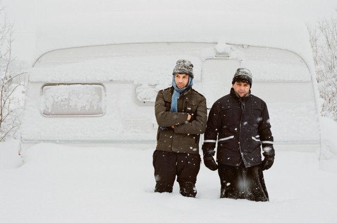 Syrian and Afghan Refugees Take Shelter in an Unlikely Home: An Arctic Hotel