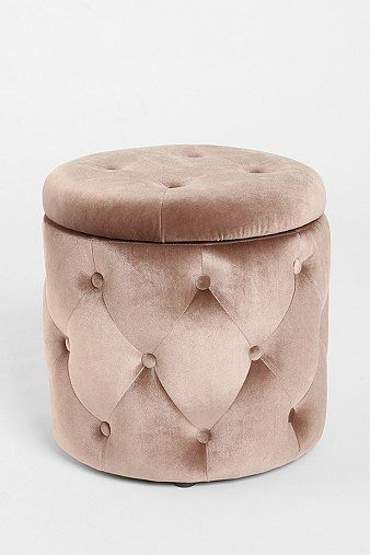 """Ava"" tufted round storage ottoman in pale pink from Urban Outfitters ($110)."