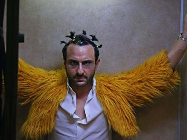 Saif Ali Khan is one busy man and why not the actor has some great films in his kitty this year. After a long wait we finally got our hands on this first still from his movie Kaalakaandi which is helmed by Delhi Belly fame director Akshat Verma. The film is made under Cienestaan Film Company banner.  In the still we see Saif in a super hilarious yet dark look. Hes seen wearing a fur jacket looking all things wacky. Kaalakaandi is a thriller dark comedy and talks about six different…