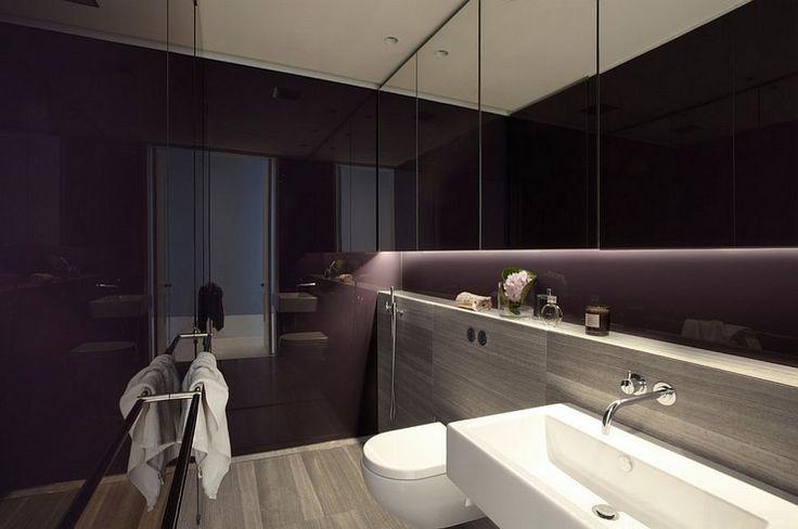 Lighting steals the show in this dark, purple bathroom [Design: Smart Design Studio]