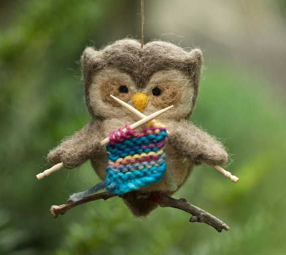Needle Felted Owl Ornament  Knitting by scratchcraft on Etsy, $24.00/ $3 US ship. This cute little owl is working intently on its first knitting project, using a soft colorful merino yarn and tiny knitting needles (is it scarf, a sweater, a washcloth?). Carefully needle felted from soft wool, it measures about 2.75 inches (from head to tail) and is about 3 inches at its widest part (wings). The string (securely attached through top) is 5 inches long.