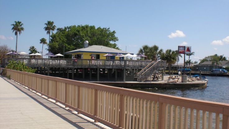 Cape Coral Beach at Cape Coral Yacht Club-had a couple of Wildberry Lemonade beach side at a table made out of a surf board!