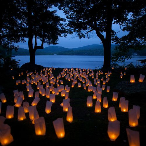 let there be light- idea for night event - brown bags filled with sand and a tea light candle.