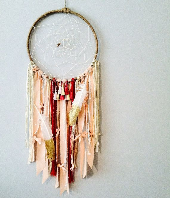 This dreamcatcher is so feminine & a gorgeous statement piece. Boho chic with its adornments of glitter dipped feathers, fabric & tassels. The
