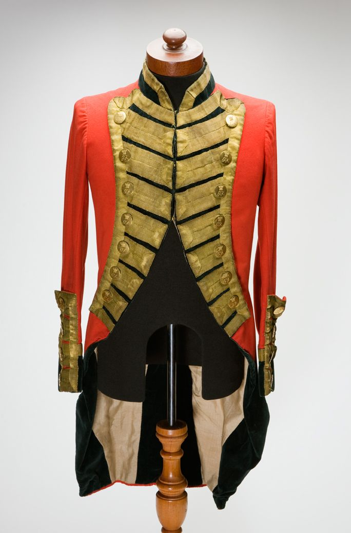 "Yeomanry Jacket This well-preserved scarlet military jacket may be a more recent copy of the distinctive tailed military dress adopted by the 18th century Volunteer Corps and Yeomanry in Ireland. It has gold braid and buttons inscribed ""GR"". The facings are of black velvet."