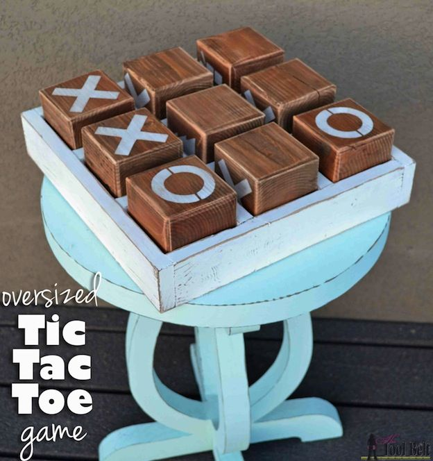 20+ DIY Yard Games that are perfect for summer entertaining, like this Oversized Tic Tac Toe Game from Her Tool Belt! These awesome lawn games for adults and kids - like cornhole, giant Jenga, Yardzee, tic tac toe + more - are perfect for backyards, camping trips, and family fun. Learn how to make DIY yard games from these easy tutorials, then enjoy these game all summer long! | Hello Little Home
