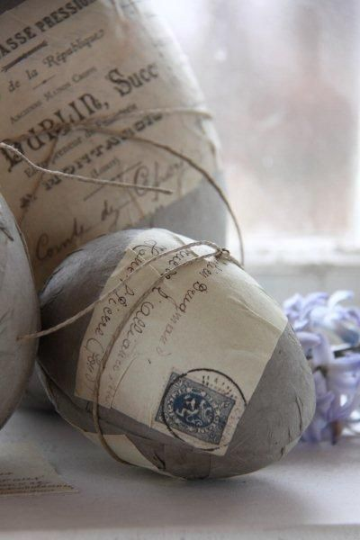 I can think of lots of ideas of things to wrap plastic eggs in. Scrapbooking paper, old music sheet, old book pages, old brown paper, etc. Then add stamps, other ephemera.