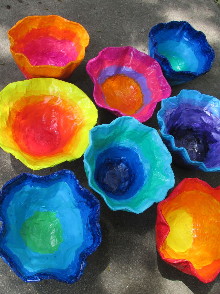 "Chihuly-inspired paper mache bowls; approx. 12""---14"" wide; lesson by art teacher: Susan Joe"