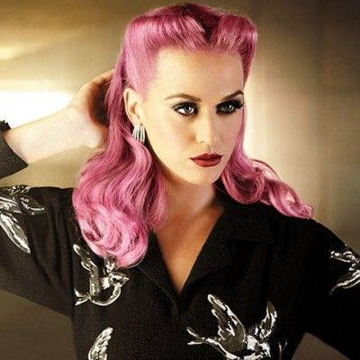 The French twist got a very beautiful reincarnation with Katy Perry giving her pale pink hair the twist and decorating it with fake blue orchids. Description from designerscloth.blogspot.com. I searched for this on bing.com/images
