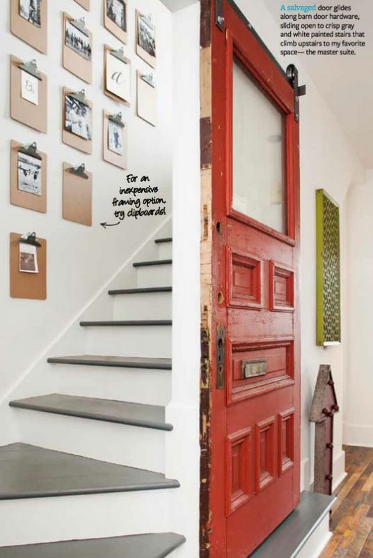 """5 Ways to Decorate with Vintage Tools CLIP BOARDS IN STAIRWELL  Use vintage door on barndoor hardware to slide over and close off the stairway..get for privacy..or cutting the heat bill in the winter to close off unused parts of the house!  LOVE the clipboards as """"frames"""" - would be cute for classroom"""