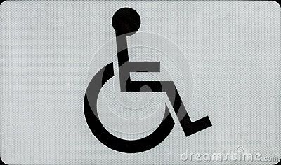 Black handicap or wheelchair accessible symbol on white background. Sign on the street.