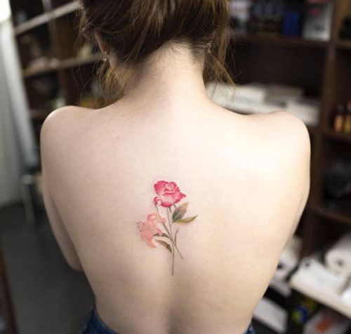 Red rose and lily tattoo on the back. Tattoo artist: Hongdam