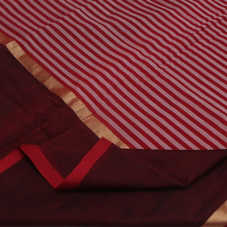 This silk cotton sari is a blend of many vibrant elements: Half & half pattern, Ganga-Jamuna border, bold red, maroon and white colours, plain border with striped body and checkered pallu and a head-turning handwoven effect. Half of the sari is plain maroon while the other half is striped. Indeed, a coming together of creative boldness. Code 510509987. #padmapaaduka #puresilkcotton #silkcotton #silkcottonsaris #handwoven #handloom #handloomlove #tradition #womenfashion #fashion #stripes