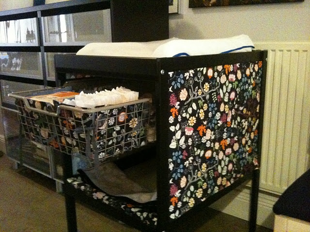 Ikea changing table hack with fabric panels to hide the diapers!