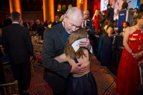 Retired Gen. and current chairman of USA Basketball Martin E. Dempsey hugs Lizzy, surviving daughter of Marine Maj. David Yaggy.(Photo: Cliff Owen)     WASHINGTON— It was the final night of the NBA regular season, but basketball couldn't have been further from the minds of...  http://usa.swengen.com/nba-usa-basketballs-partnership-with-taps-much-bigger-than-sports/