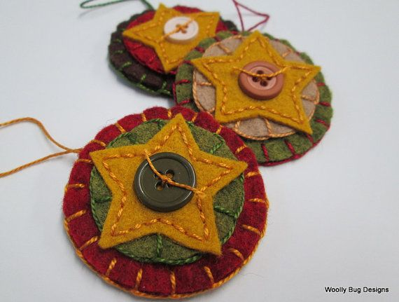 All hand cut out of wool felt, these simple folk art stars are then freehand stitched onto wool felt ornaments and accented with buttons from my button collection. The colors are a combination of golden yellow, chocolate brown, forest green and country red. All handmade from wool blend felt that I dampen and then tumble dry to add a nice texture to the felt. Made with joy for you to enjoy!    Collect them in a bowl or basket for display. Decorate the cabinet doors. Tie onto gifts. Bring in…