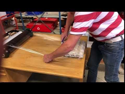 H. Clausen AS: LiteWrapper XT brukt på pakkebord med holdere.