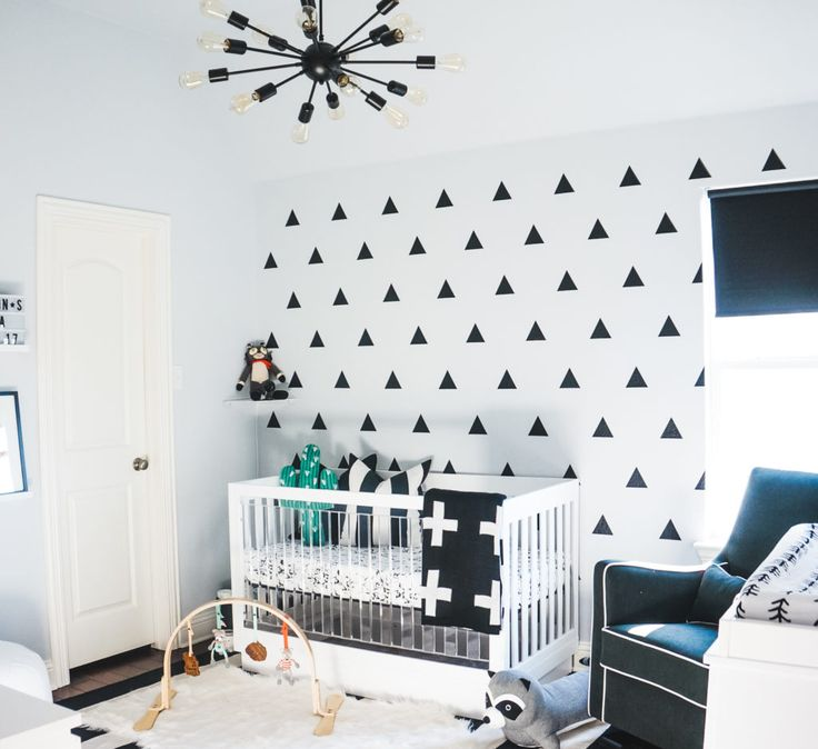 Every little detail of this black and white nursery is amazing, including the showstopping triangle wall decals. They really take the space to the next level!