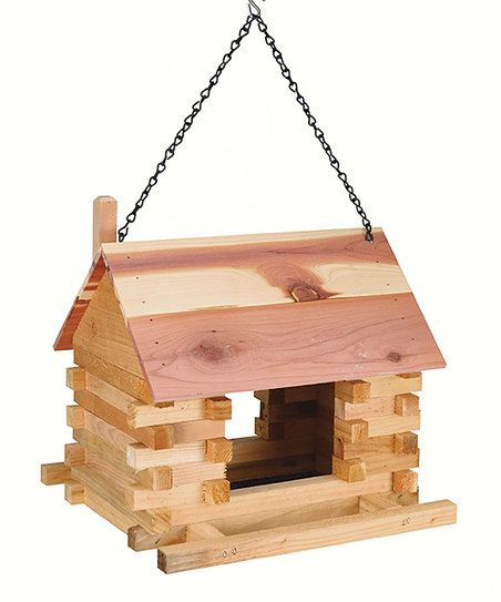 Watch as feathered friends flock to your outdoor space with this charming bird feeder.