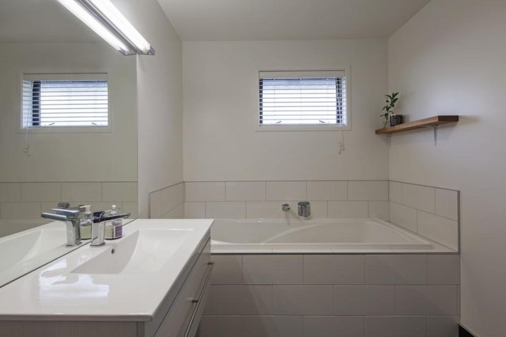 Fresh Bathroom Style | All White Bathroom, Small Bathroom Space, Kid Friendly Bathroom Design | Shotover Country Home | NZ Homes | buildme.co.nz