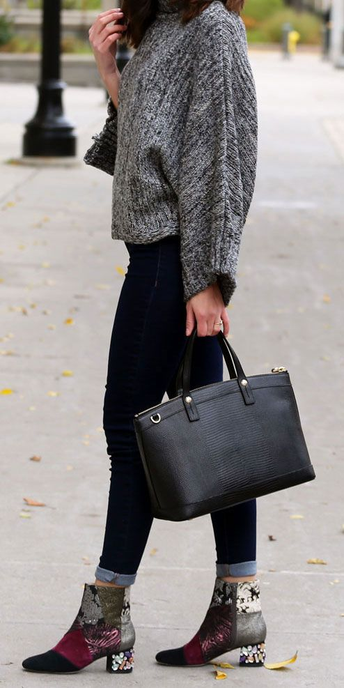 Fall sweaters are the best, especially this super affordable one! Fashion blogger Marie's Bazaar pairs it with flattering skinny jeans from Dynamite Clothing, statement booties from Bettye Muller, and a Henri Bendel black satchel. Perfect outfit for cold days