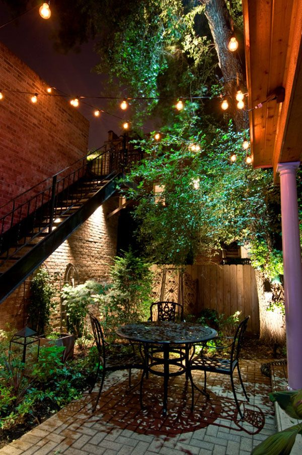 String lights, bistro table, greenery, intimate patio - perfection