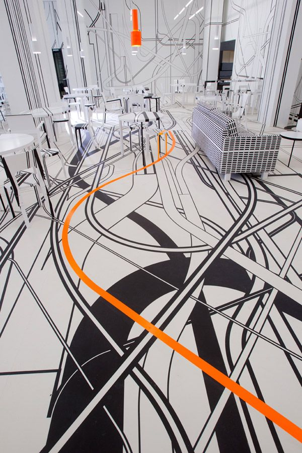 """German artist Tobias Rehberger likes to shake things up. Since stepping on the scene 15 years ago, he's turned to a variety of mediums to toy with perception, consistently challenging his audience to see the """"things which cannot be seen."""" His latest work transforms the interior of a cafe in Finland's cultural capital Turku into a mind-boggling display of criss-crossing lines, an installation he conceived in collaboration with Artek."""