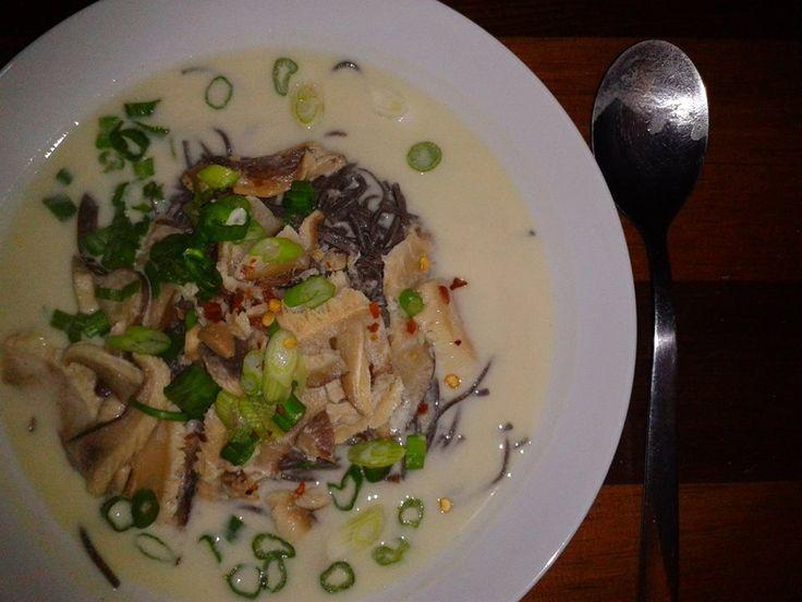 Tom kai Kai vegan soup with veggie broth, coconut milk, chili pepper falkes, shitake mushrooms, green onions, fresh grated ginger, juice of 1 lemon and black bean spaghetti. yum