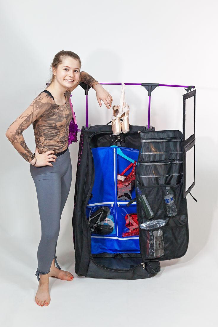 """Dance Tower dance bag.  The next """"it"""" rolling closet dance bag.  Holds up to 15 costumes. Multiple storage pockets and compartments to store shoes, accessories etc. Unique stand up design so that you don't have to fold your costume garment bags. Quick setup. Rack holds up to 25 lbs! Collapses for easy storage when not in use.  Exclusively sold by All About Attitude Dancewear"""