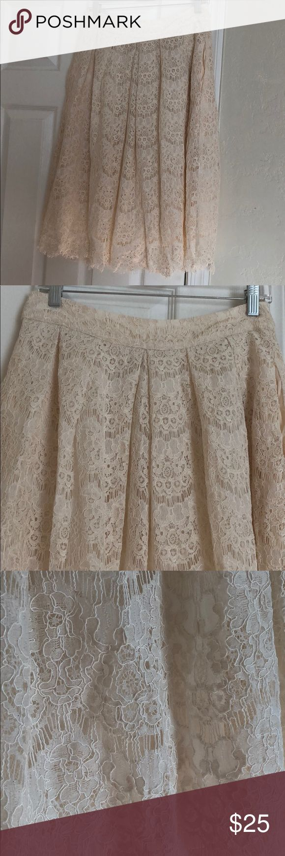 Beautiful cream lace skirt  for Spring! Beautiful cream lace skirt.  Zips I'm back. Has pockets. Never worn. Perfect condition. Comes from a pet and smoke free home. Ryu Skirts Midi