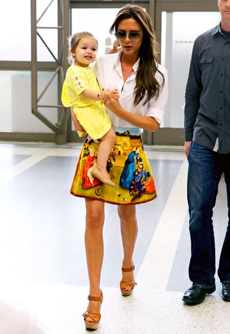 Victoria Beckham wore Carven's multicolor renaissance printed velvet skirt and brown Chloe wedges on June 1, 2013.