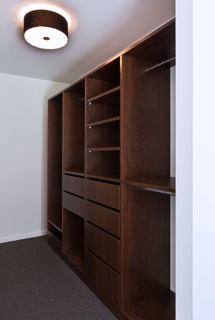 The master bedroom walk in wardrobe offers plenty of storage.